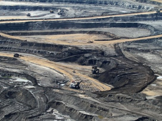 but-thousands-flock-here-to-make-real-money-in-the-oil-sands--where-creating-synthetic-crude-begins-in-the-strip-mine