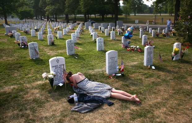 """ARLINGTON, VA - MAY 27:  Mary McHugh mourns her dead fiance Sgt. James Regan at """"Section 60"""" of the Arlington National Cemetery May 27, 2007. Regan, an American Special Forces soldier, was killed by an IED explosion in Iraq in February of this year, and this was the first time McHugh had visited the grave since the funeral. Section 60, the newest portion of the vast national cemetery on the outskirts of Washington D.C, contains hundreds of U.S. soldiers killed in Iraq and Afghanistan. Family members of slain American soldiers have flown in from across the country for Memorial Day.  (Photo by John Moore/Getty Images) *** Local Caption *** Mary McHugh"""